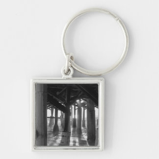 Golden Light Shines Through Grayscale Silver-Colored Square Key Ring