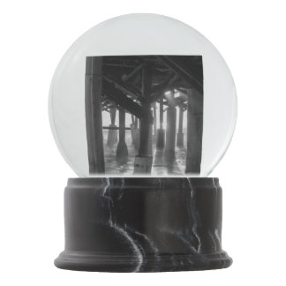 Golden Light Shines Through Grayscale Snow Globe