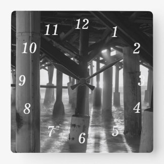 Golden Light Shines Through Grayscale Square Wall Clock