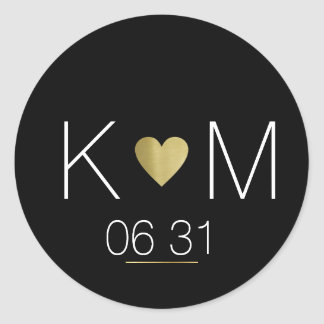 Golden love heart with couple names on black classic round sticker