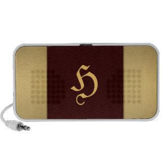 Golden metallic speaker with monogram