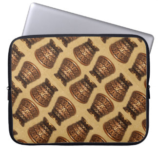 Golden mulberry leaf urn on sand laptop sleeve