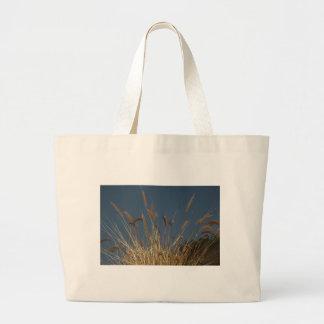 Golden Plant on Dark Sky Canvas Bags