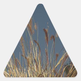 Golden Plant on Dark Sky Triangle Sticker