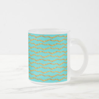 Golden princesslike patterns on aqua frosted glass coffee mug