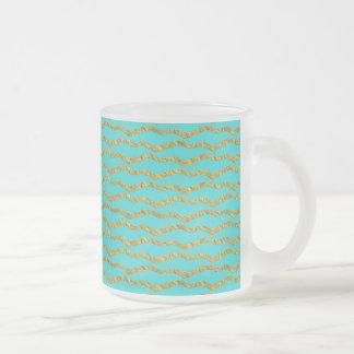 Golden princesslike patterns on aqua frosted glass mug