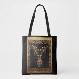 Golden raven tote bag