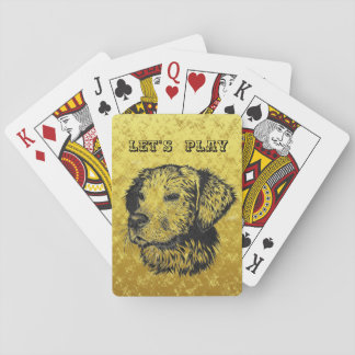 Golden retriever puppy portrait in black and gold playing cards