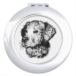 Golden retriever puppy portrait in black and white vanity mirror