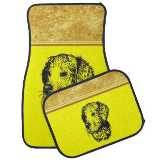 Golden retriever puppy with gold foil and yellow car mat
