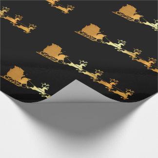 Golden Santa on black X-mas wrapping paper