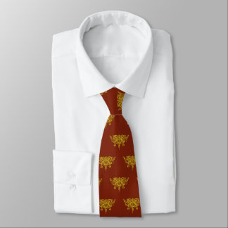 Golden scales and sword of justice on ruby red tie