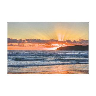Golden Sunbeams Over Ocean Canvas Print