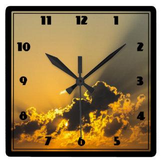 Golden Sunset Illuminating a Cloud Square Wall Clock