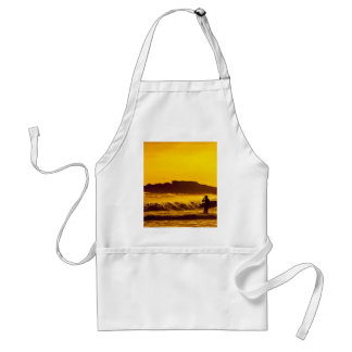 Golden Themed, A Surfer Stands In The Water With H Standard Apron