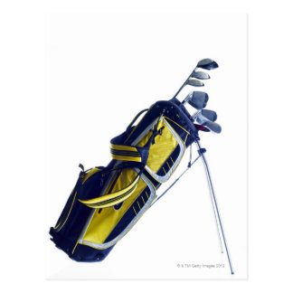Golf bag with clubs on white background postcard