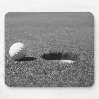 Golf Ball beside hole Mouse Pad