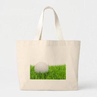 Golf Ball In Grass Canvas Bags