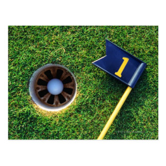 golf ball in hole postcard