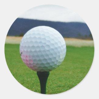 Golf Ball on a mountain golf course Round Sticker