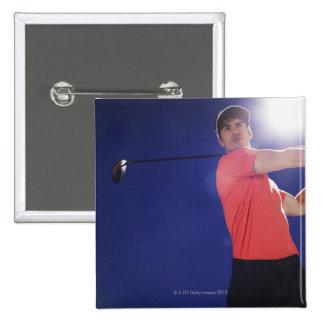 Golf player swinging club 15 cm square badge