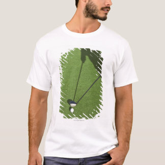 Golfer with driver prepares for swing T-Shirt