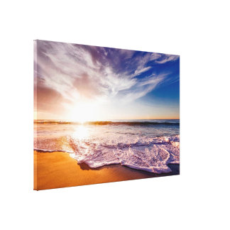 Gorgeous Waves on a Sandy Beach and Sunset Canvas Print