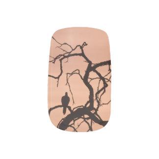 Gothic bird on a tree with evening sky minx nail art