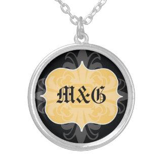 Gothic letter monogram initial yellow black emblem pendant