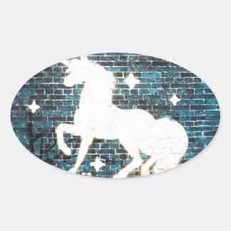 Graffiti Unicorn on Blue Brick Wall Oval Sticker