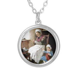 Grandmother and granddaughter sewing custom necklace