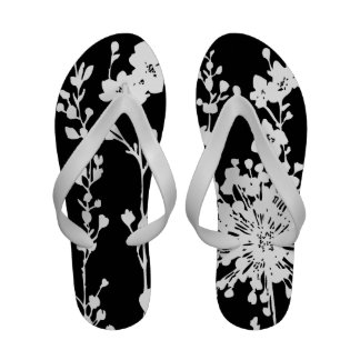 Graphic black and white floral print flip flops