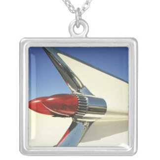 Graphic: Close-up of fin and taillight on Square Pendant Necklace