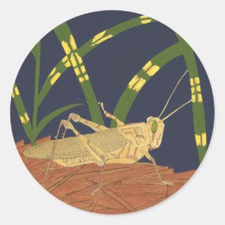 Grasshopper in Green Grass on Blue Background Round Sticker