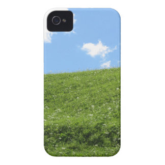 Grassy field at the rolling hill against the sky iPhone 4 case