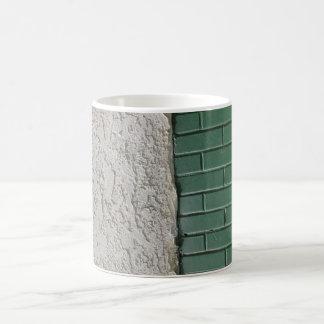 gray and green mugs