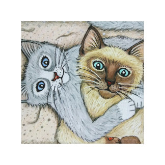 Gray cat and Siamese kitty , snuggling Canvas Print