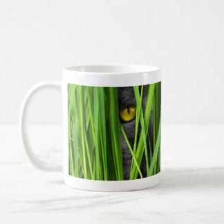 Gray Yellow Eyed Cat Hiding in the Grass Coffee Mug