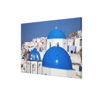 Greece, Santorini. Bell tower and blue domes of Canvas Print