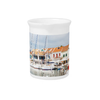 Greek harbor with sailing boats in Fiskardo Pitcher