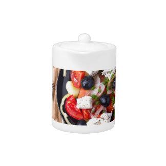 Greek vegetarian salad of tomatoes, cucumbers, oni