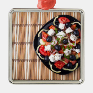 Greek vegetarian salad of tomatoes, cucumbers, oni Silver-Colored square decoration