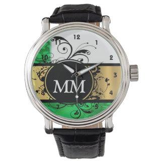 Green and black monogram on white wristwatch