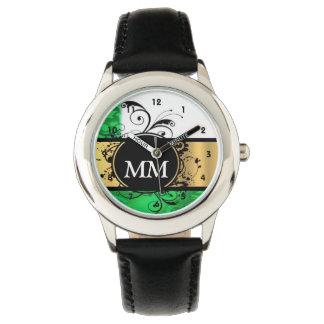 Green and black monogram on white wristwatches