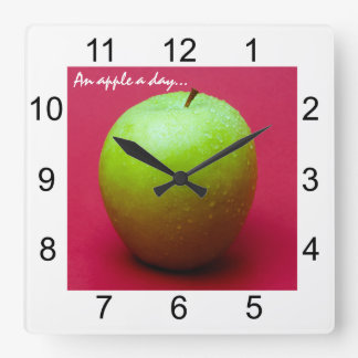 Green apple on red background square wall clock