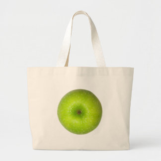 Green apple top view tote bags