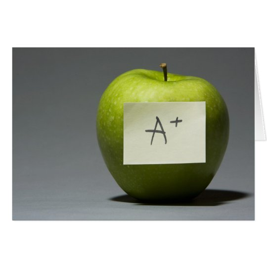 Green apple with adhesive note with letter A and Card