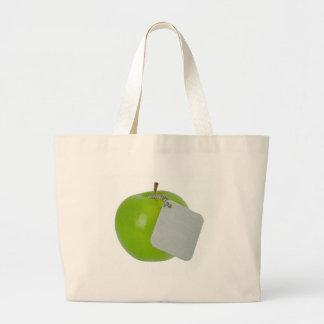 Green apple with metal tag bag