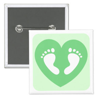 Green baby feet or footprints in heart button