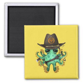 Green Baby Octopus Zombie Hunter Magnet